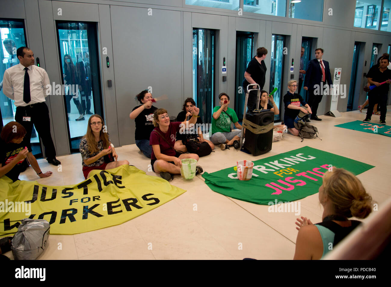 London, UK. 8th August, 2018. Ministry of Justice, Petty France, London. Cleaners from the United Voices of the World Union strike for three days demanding they be paid the London Living Wage of £10.20 an hour instead of the minimum wage of £7.83 that they currently get. Cleaners and their supporters occupied the Ministry for over an hour until a meeting was arranged with a Minister's representative, a meeting they have been requesting since December 2017. Credit: Jenny Matthews/Alamy Live News - Stock Image