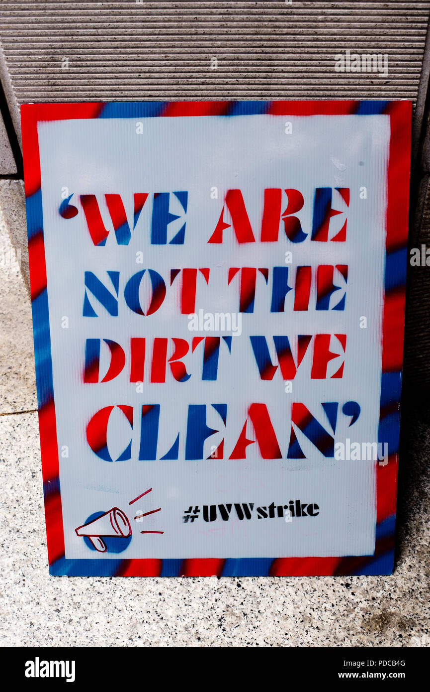 London, UK. 8th August, 2018. Ministry of Justice, Petty France, London. Cleaners from the United Voices of the World Union strike for three days demanding they be paid the London Living Wage of £10.20 an hour instead of the minimum wage of £7.83 that they currently get. A placard says 'We are not the dirt we clean'. Credit: Jenny Matthews/Alamy Live News - Stock Image