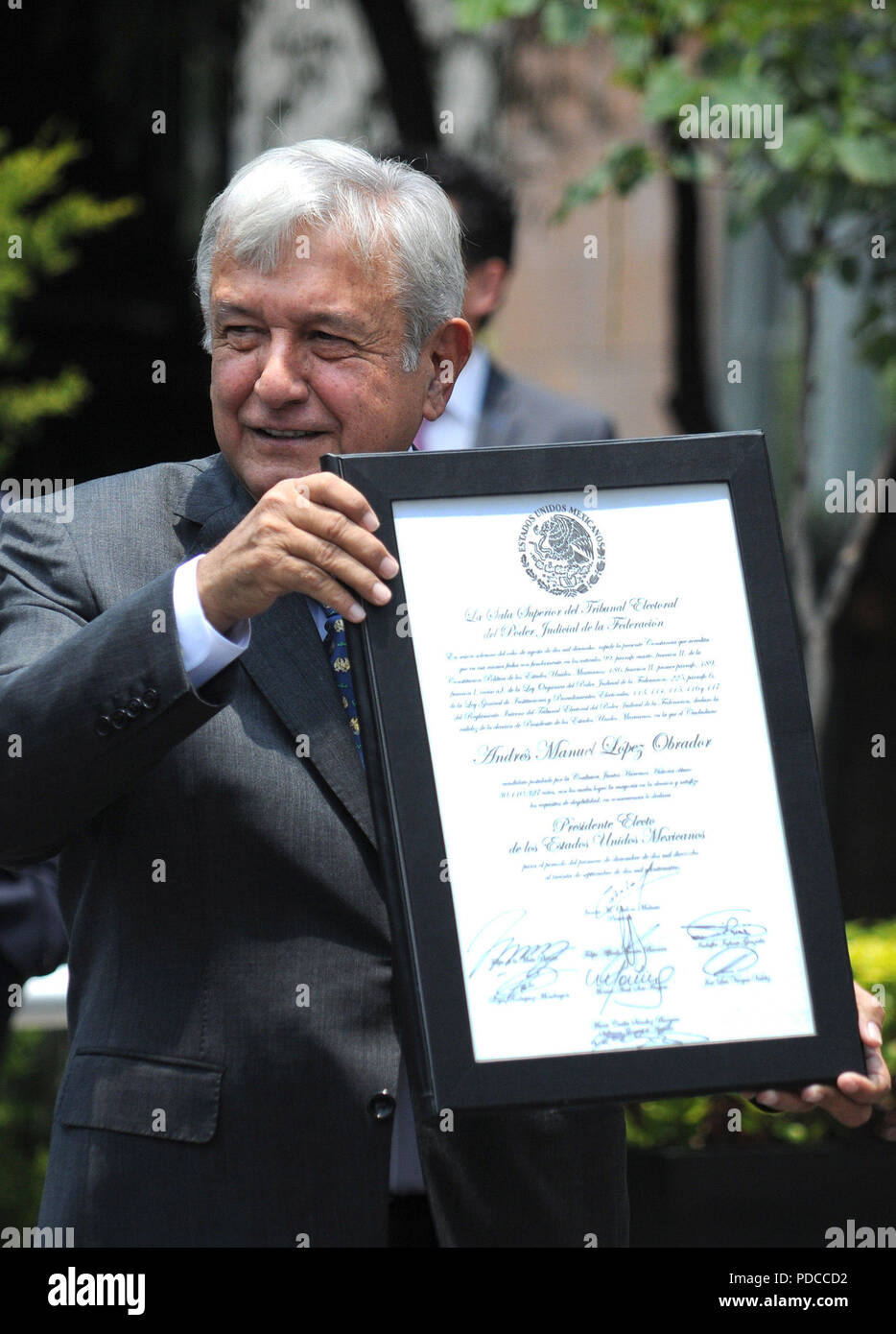 Mexico City, Mexico. 8th August, 2018. Mexican President-elect Andres Manuel Lopez Obrador shows his majority certificate as he arrives at the Electoral Court of the Federation's Judicial Power, in Mexico City, Mexico, 08 August 2018. The Court validated the Mexican election and Obrador's victory. EFE/Mario Guzman Credit: EFE News Agency/Alamy Live News Stock Photo