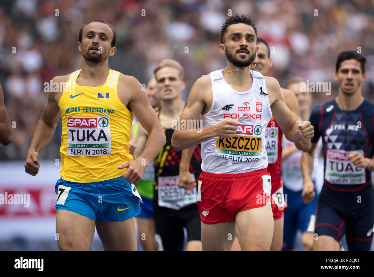 Berlin, Germany. 09th Aug, 2018. Track and Field, European Championships in the Olympic Stadium, 800m, preliminary round, Men. Adam Kszczot from Poland (r) and Amel Tuka from Bosnia and Herzegovina in action. Credit: Sven Hoppe/dpa/Alamy Live News - Stock Image