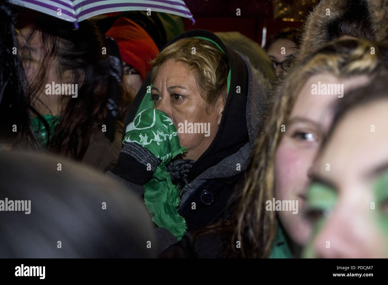 Buenos Aires, Federal Capital, Argentina. 8th Aug, 2018. In the vicinity of the Congress of the Argentine Nation the people who were in favor of the approval of the Law of Free and Legal Abortion observe incredulous and with much frustration as the majority of the senators were voting against, despite having been approved in chamber of deputies, which would force to introduce a new proposal of law next year (2019), all this under a constant rain, strong winds and temps that came to be below 7º C. Credit: Roberto Almeida Aveledo/ZUMA Wire/Alamy Live News - Stock Image