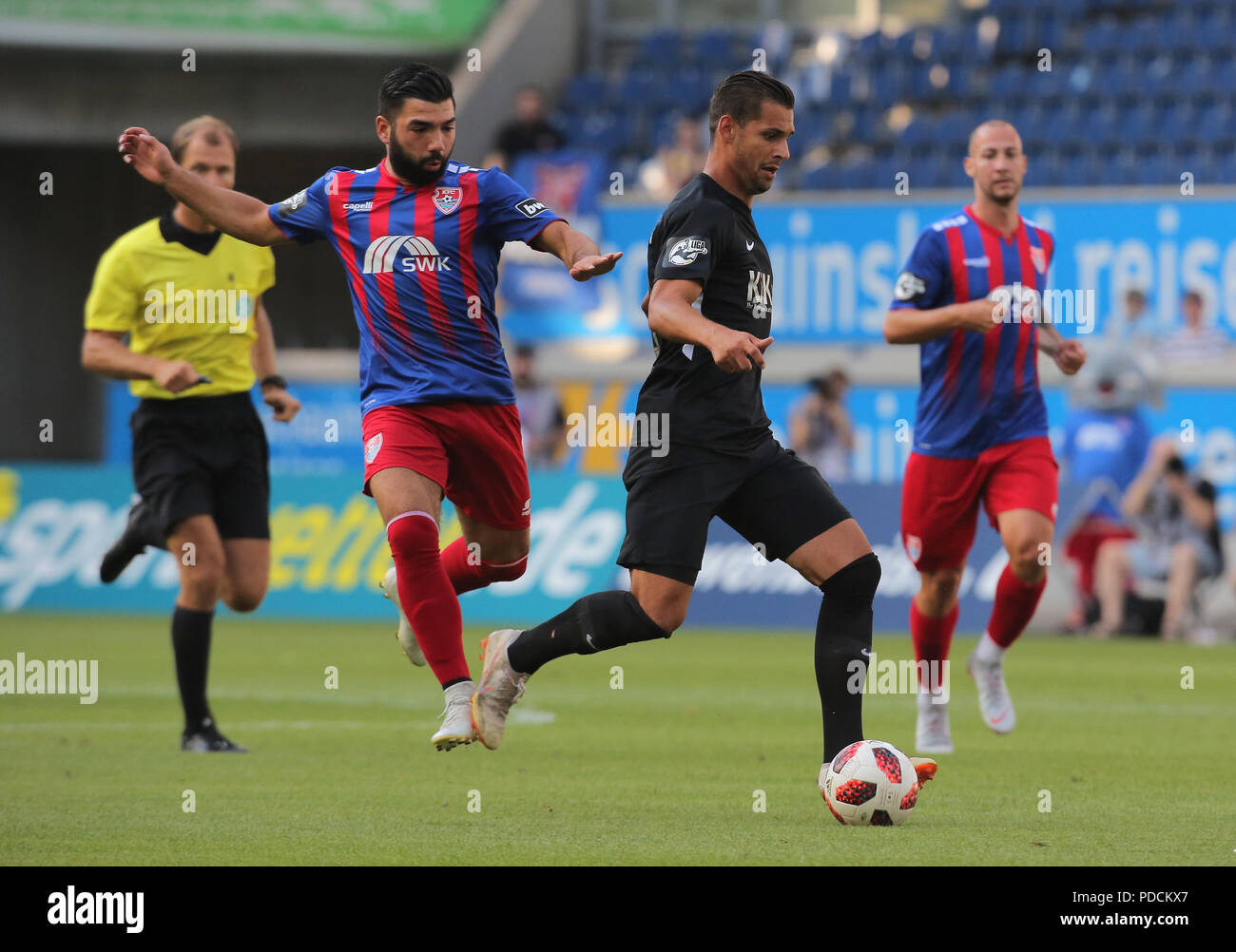 Duisburg, Germany. 08th Aug, 2018. Duisburg, Germany August 8 2018, 3rd league matchday 3, KFC Uerdingen 05 vs SV Meppen: Oguzhan Kefkir (KFC), Luka Tankulic (SVM) in competition. Credit: Juergen Schwarz/Alamy Live News - Stock Image