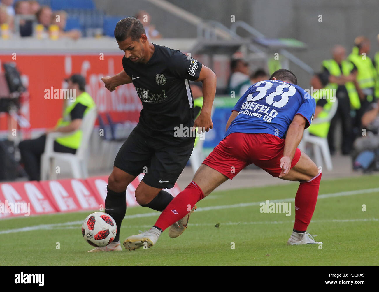 Duisburg, Germany. 08th Aug, 2018. Duisburg, Germany August 8 2018, 3rd league matchday 3, KFC Uerdingen 05 vs SV Meppen: Luka Tankulic (SVM), Oguzhan Kefkir (KFC) in competition. Credit: Juergen Schwarz/Alamy Live News - Stock Image
