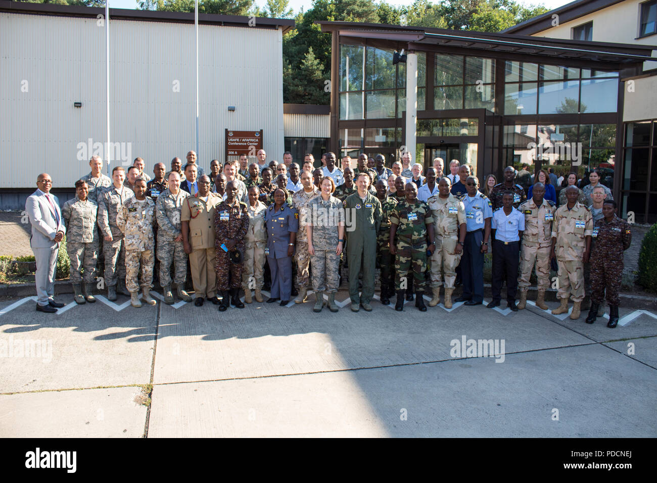 Participants from seven different African partner nations and U.S. Service Members pose for a group photo during African Partnership Flight hosted by U.S. Air Forces Africa and co-hosted by Mauritania and Senegal at Ramstein Air Base, Germany, Aug. 6, 2018. The APF program is Air Forces in Africa's premier security cooperation program with African partner nations to improve professional military aviation knowledge and skills. (U.S. Army photo by Spc. Craig Jensen) - Stock Image