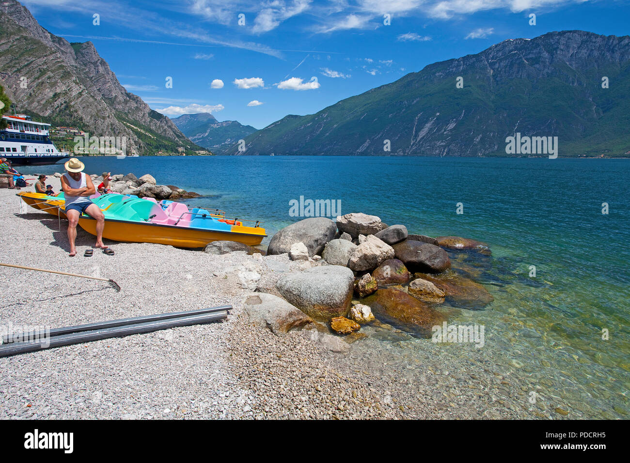 People at the beach of Limone, Limone sul Garda, Garda lake, Lombardy, Italy Stock Photo