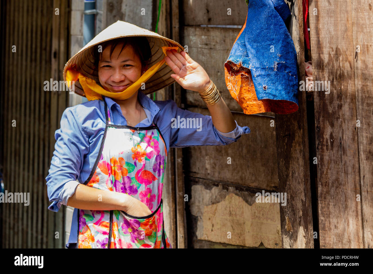 Ho chi minh city asia may 12 2018 woman wearing a vietnamese ho chi minh city asia may 12 2018 woman wearing a vietnamese hat posing and greeting in saigon m4hsunfo