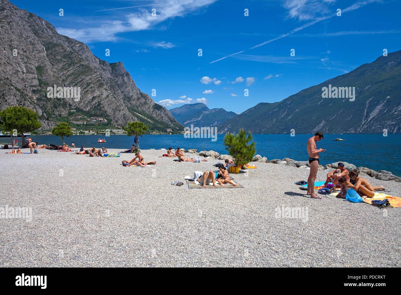 People at the beach of Limone, Limone sul Garda, Garda lake, Lombardy, Italy - Stock Image