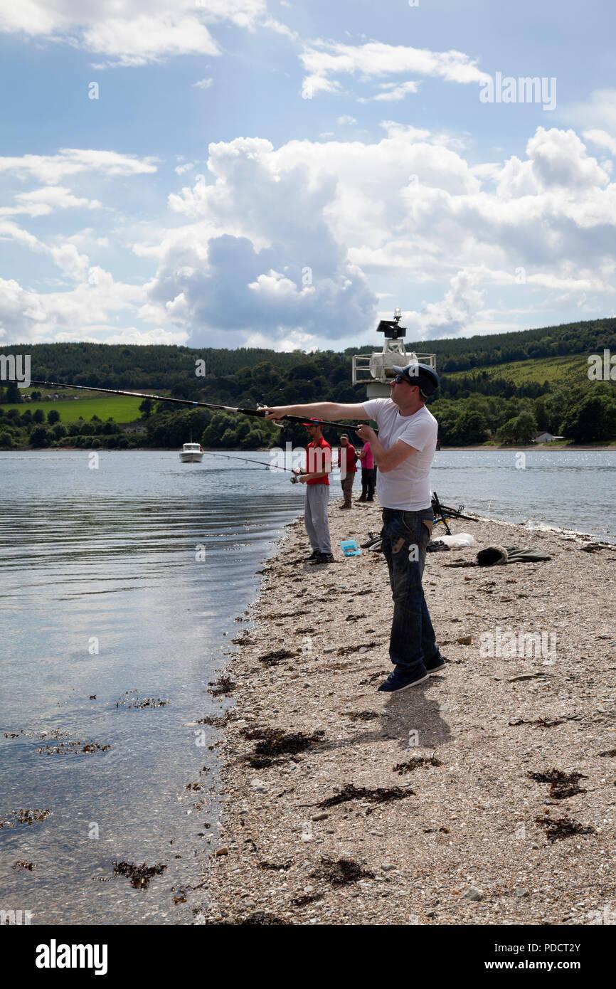 Sea Anglers fishing for mackerel from Rhu Point, Gareloch, Argyll, Scotland - Stock Image