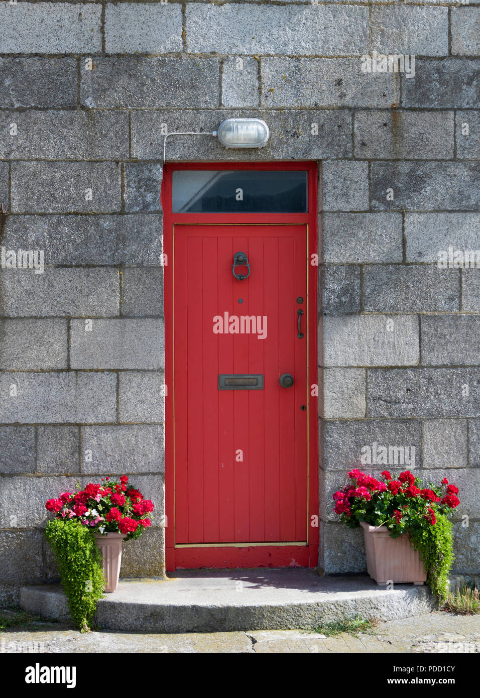 A tight shot of the red front door on Howth Lighthouse. - Stock Image