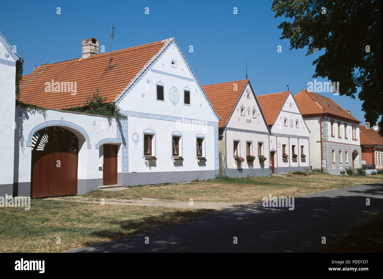 Ancient buildings in the historic village of Holasovice in South Bohemia in the Czech Republic - Stock Image