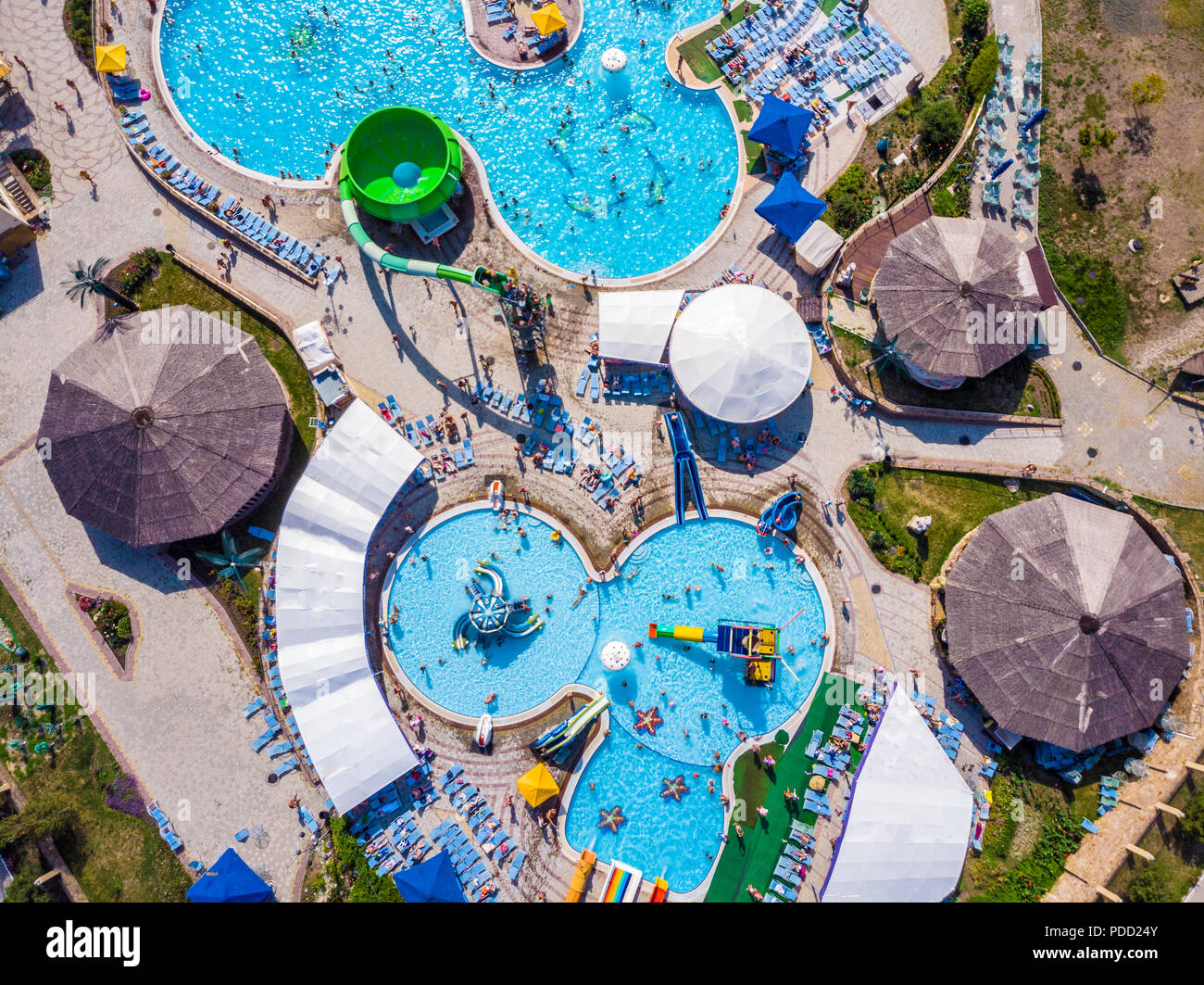 Aerial drone view looking straight down from above colorful summer time fun at water park Stock Photo