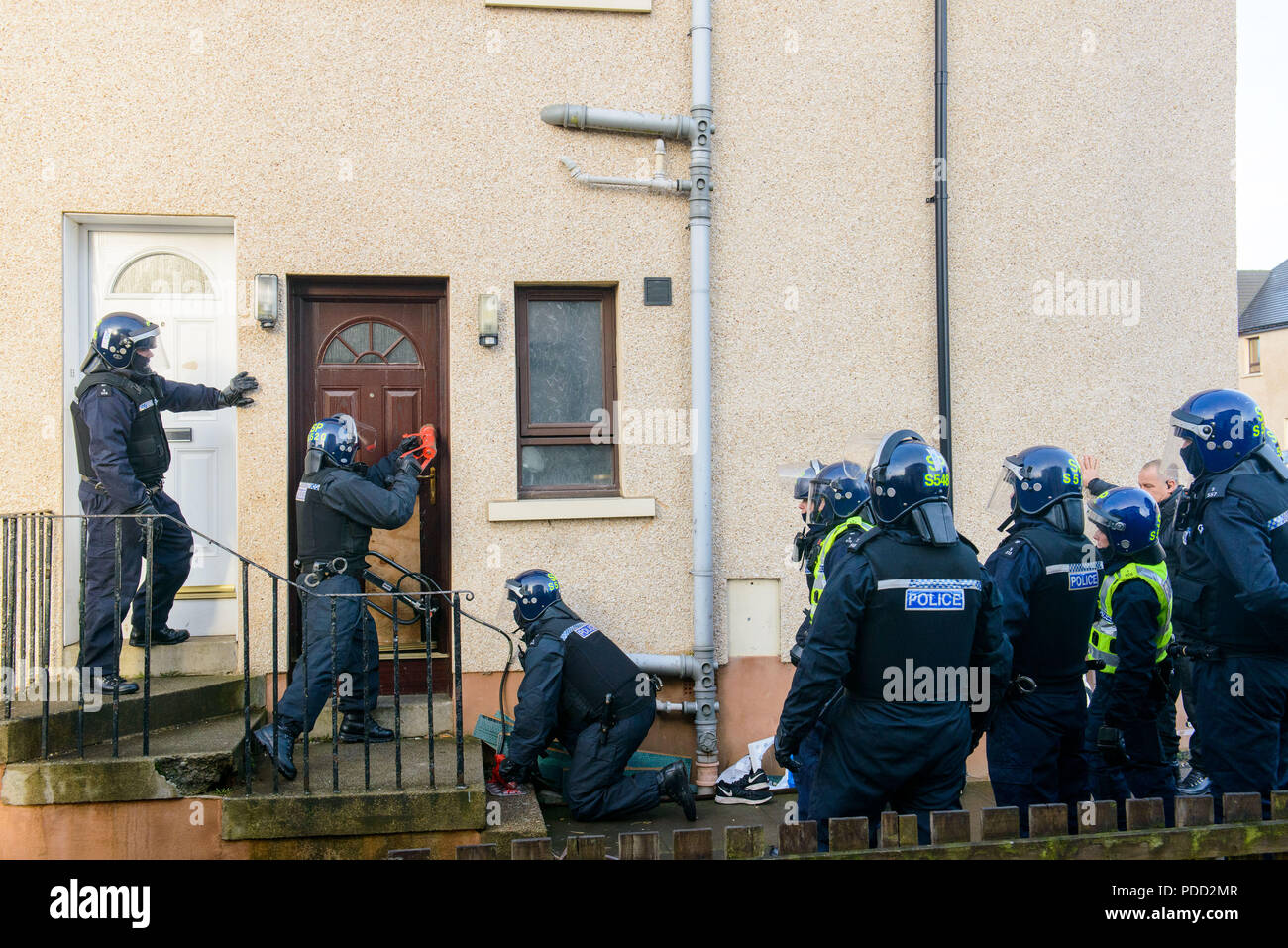 www.iangeorgesonphotography.co.uk Police Scotland Drugs Raid in Blackburn West Lothian, Operation Newbury, Heroin, cash and weapons was found using a  - Stock Image