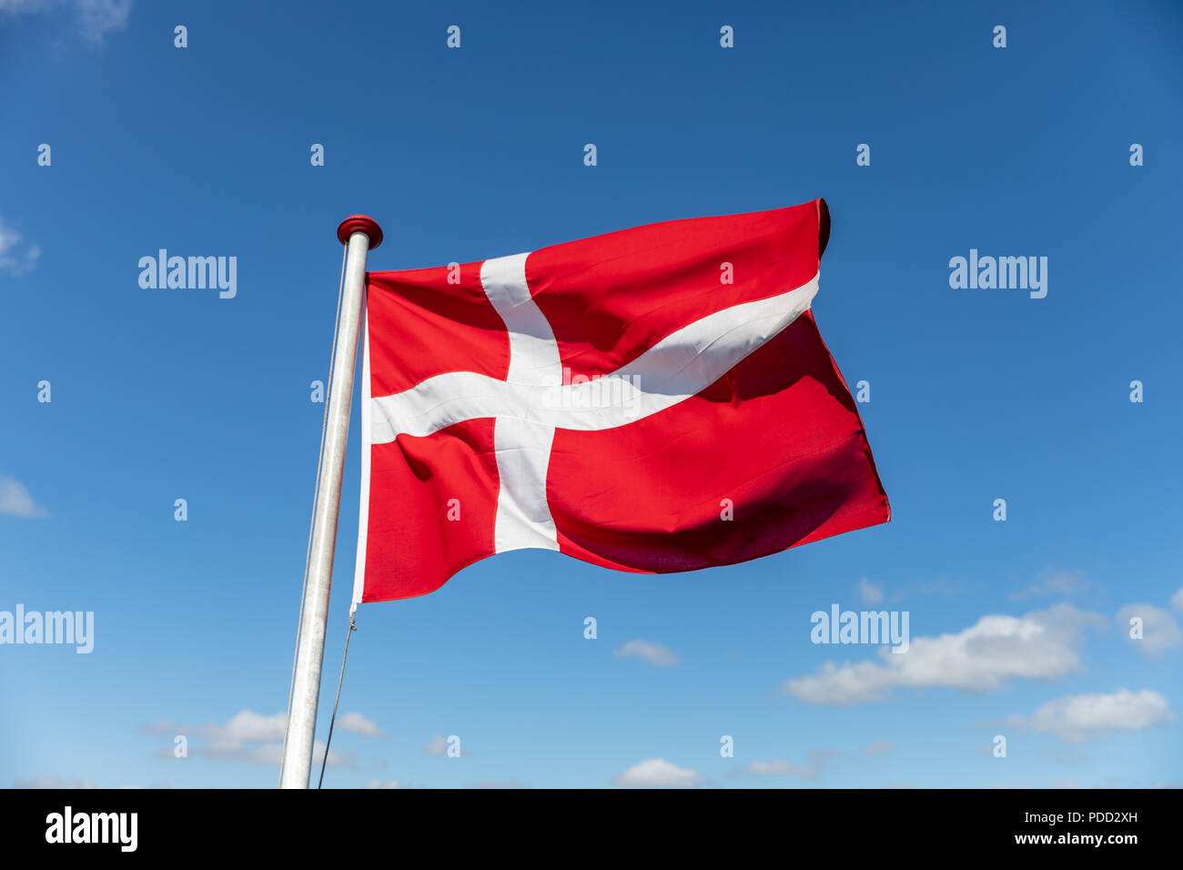 Danish flag against blue sky Stock Photo