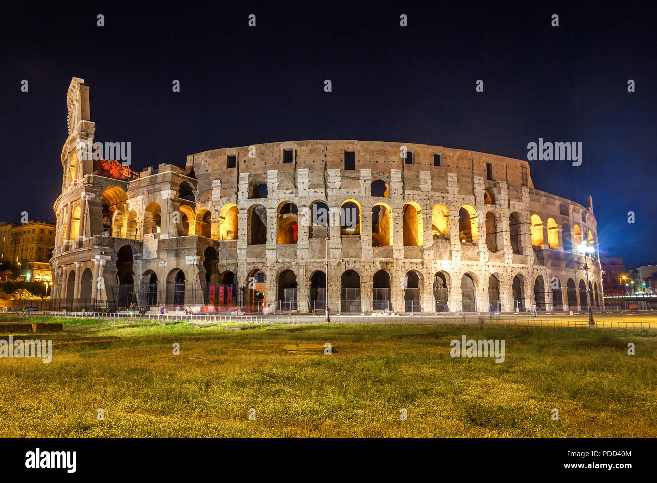 Roman Colosseum (Coliseum) at night, one of the main travel attractions in Rome. Italy. - Stock Image
