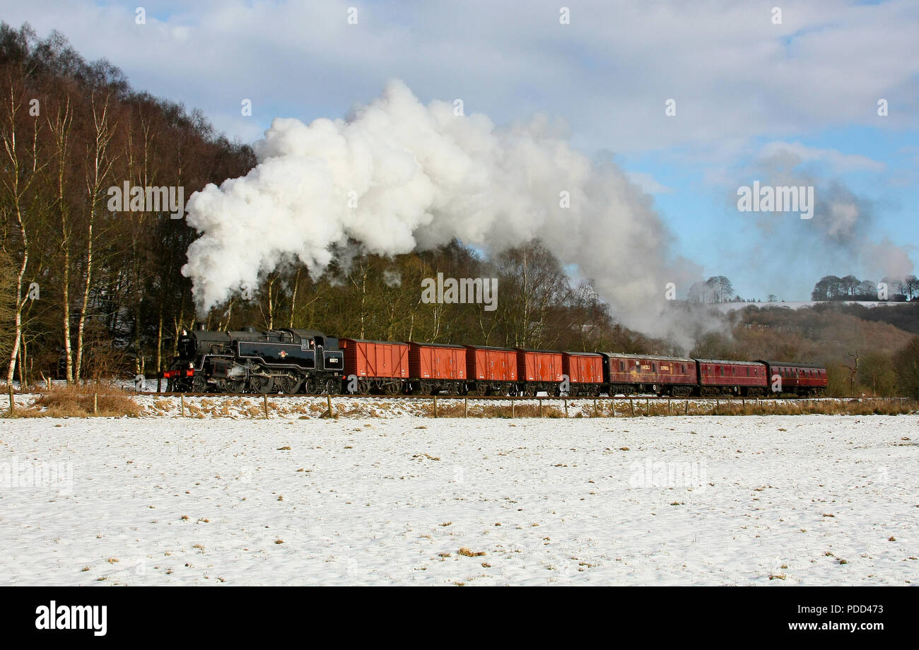 Standard Tank 80072 approaches Cheddleton on the Churnet Valley Railway. - Stock Image
