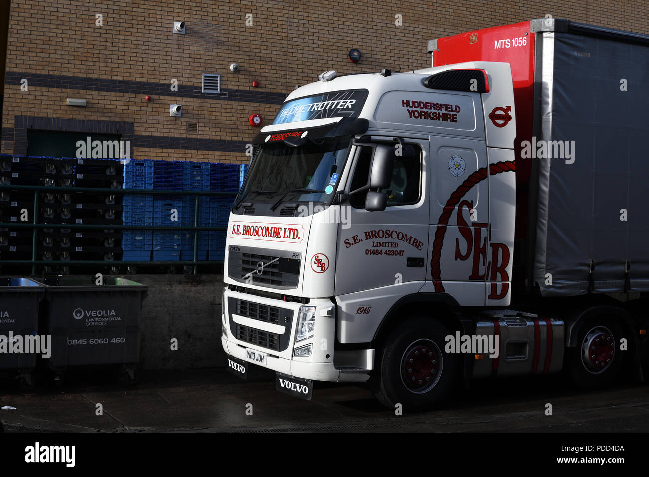 Huddersfield-based haulier makes a palletised delivery at an urban retail park Stock Photo