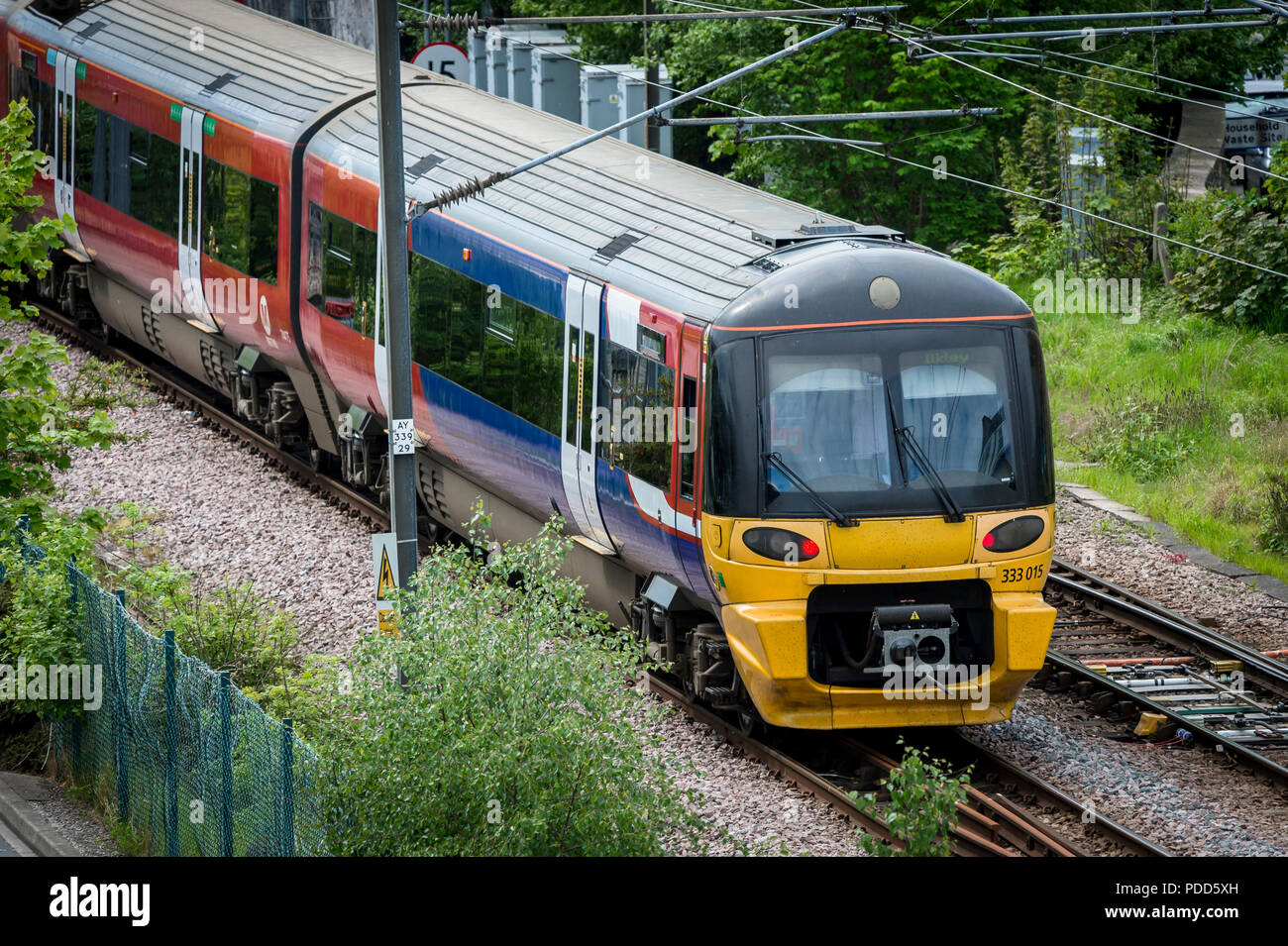 Class 333 passenger train in Northern livery travelling towards Ilkley in West Yorkshire. - Stock Image