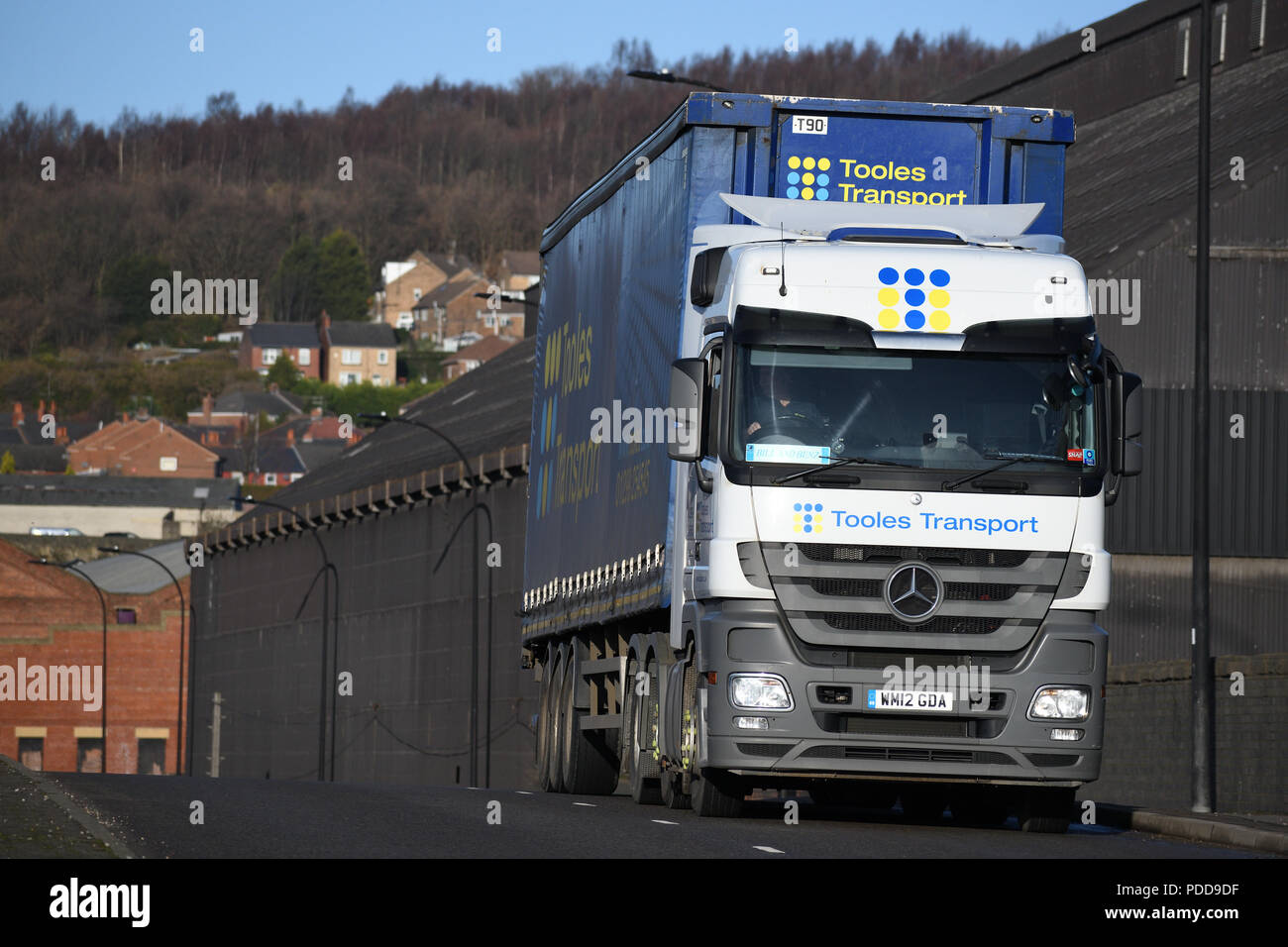 Mercedes-Benz Actros curtainsider truck passes Firth Brown steel works in Sheffield Stock Photo