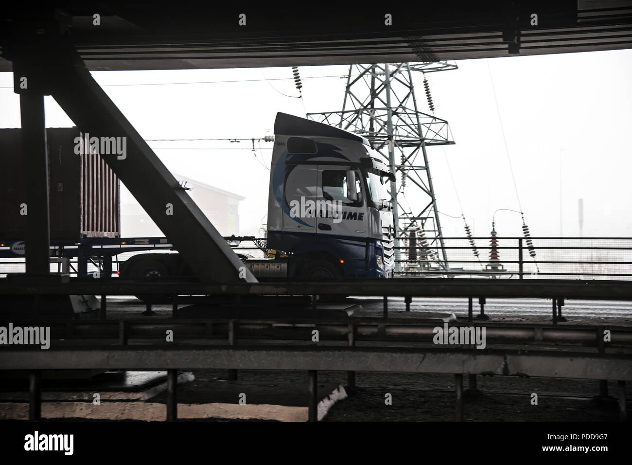 Maritime Transport Mercedes-Benz Actros container truck crosses the lower deck of Tinsley Viaduct, Sheffield. - Stock Image