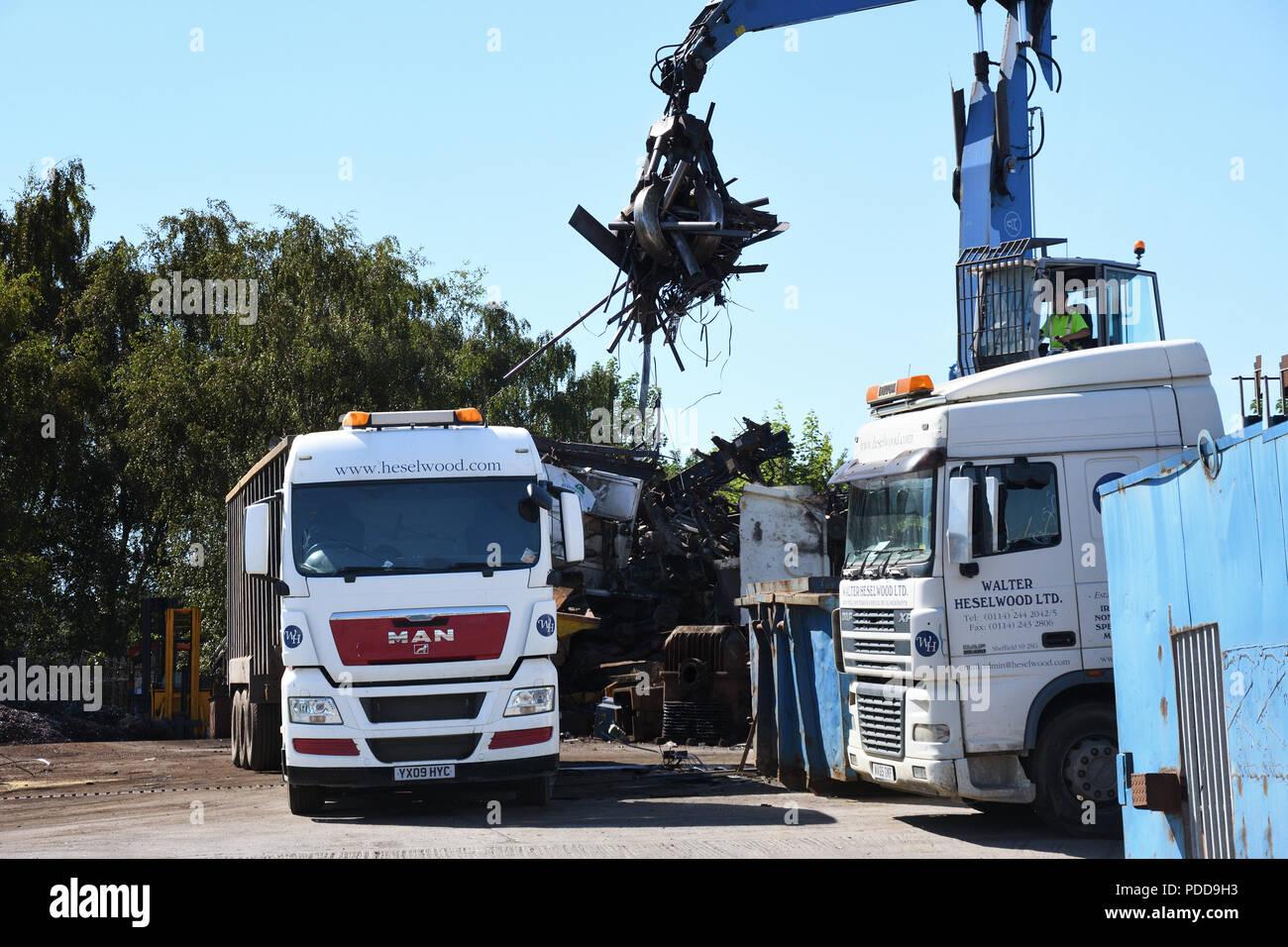 MAN bulk tipper being loaded with scrap metal in a Sheffield scrap yard - Stock Image
