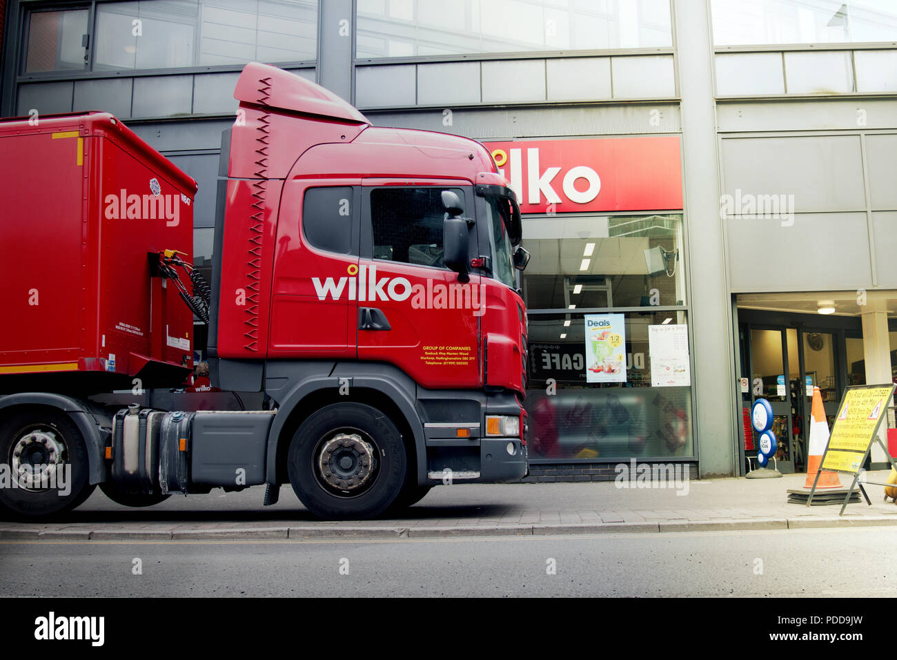 Scania container truck making final mile urban delivery Stock Photo