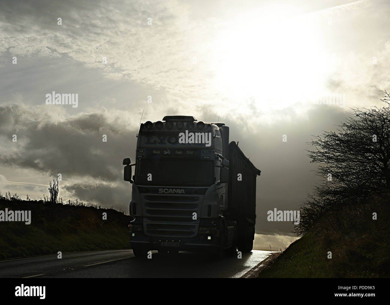 Scania bulk tipper on country road in Winter twilight Stock Photo