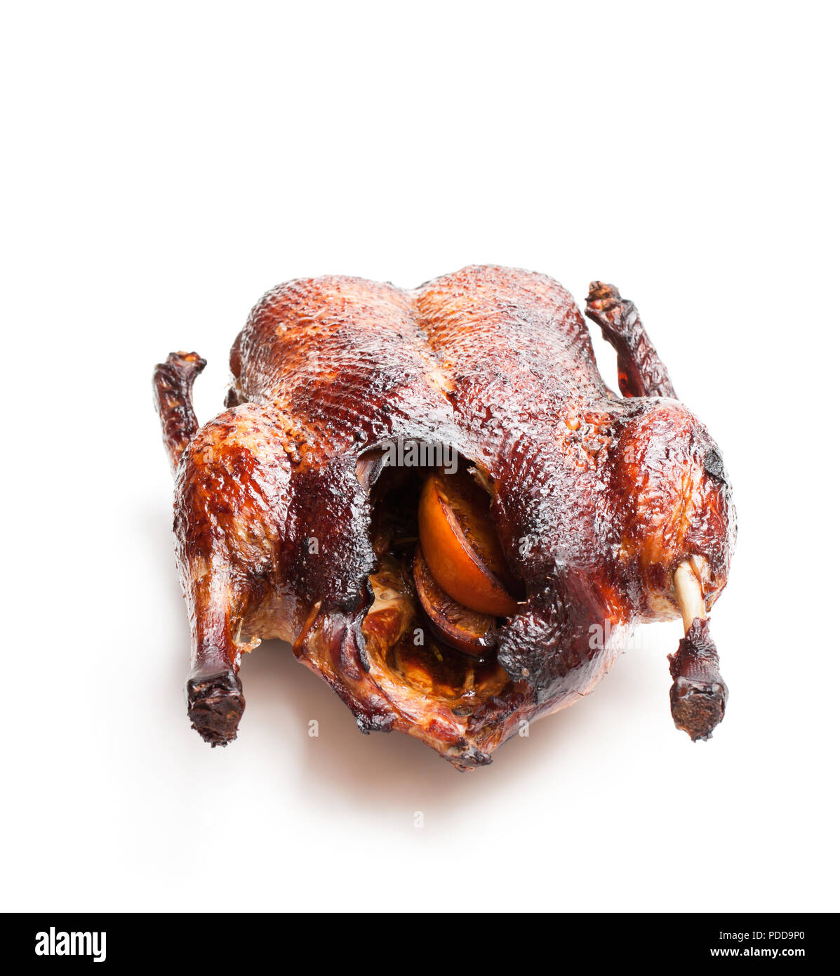 Roasted  duck stuffed with oranges isolated on white - Stock Image