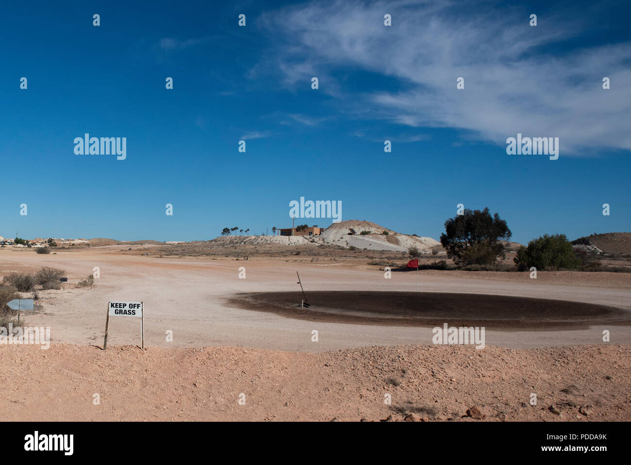 Australia, South Australia, Coober Pedy. Unique Opal Fields Golf Club, 18 hole completely grassless golf course, Keep Off the Grass sign. Oil soaked ' - Stock Image