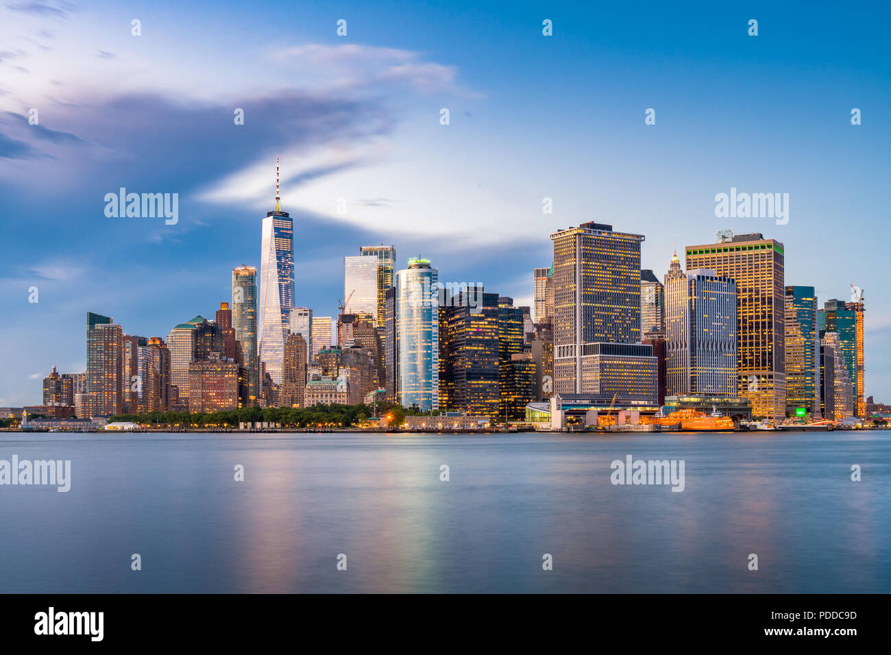 New York, New York, USA Lower Manhattan Financial district city skyline from across the New York Harbor at dusk. - Stock Image