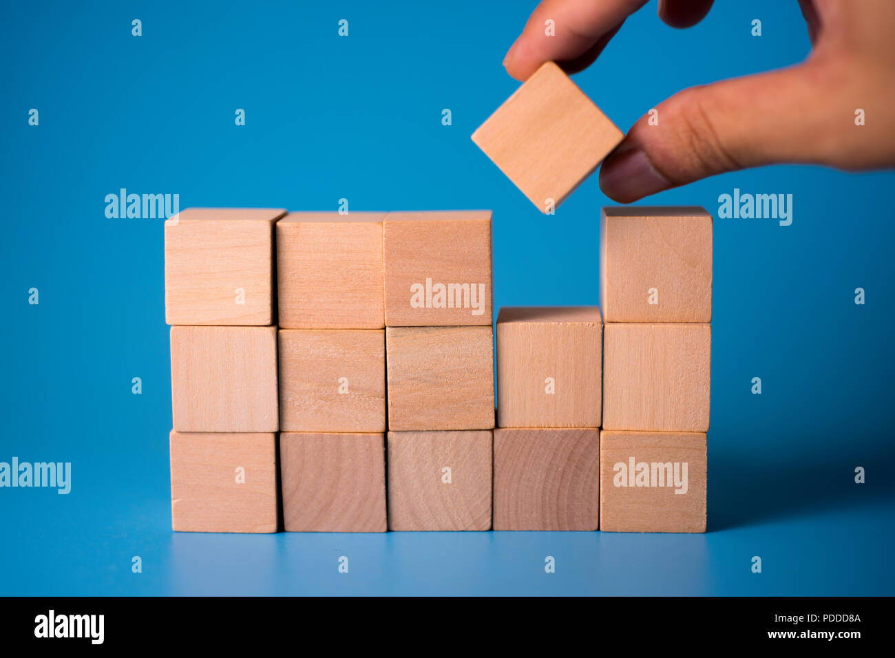 Hand Fill Square Wood Block Into Empty Space Business Concept Of