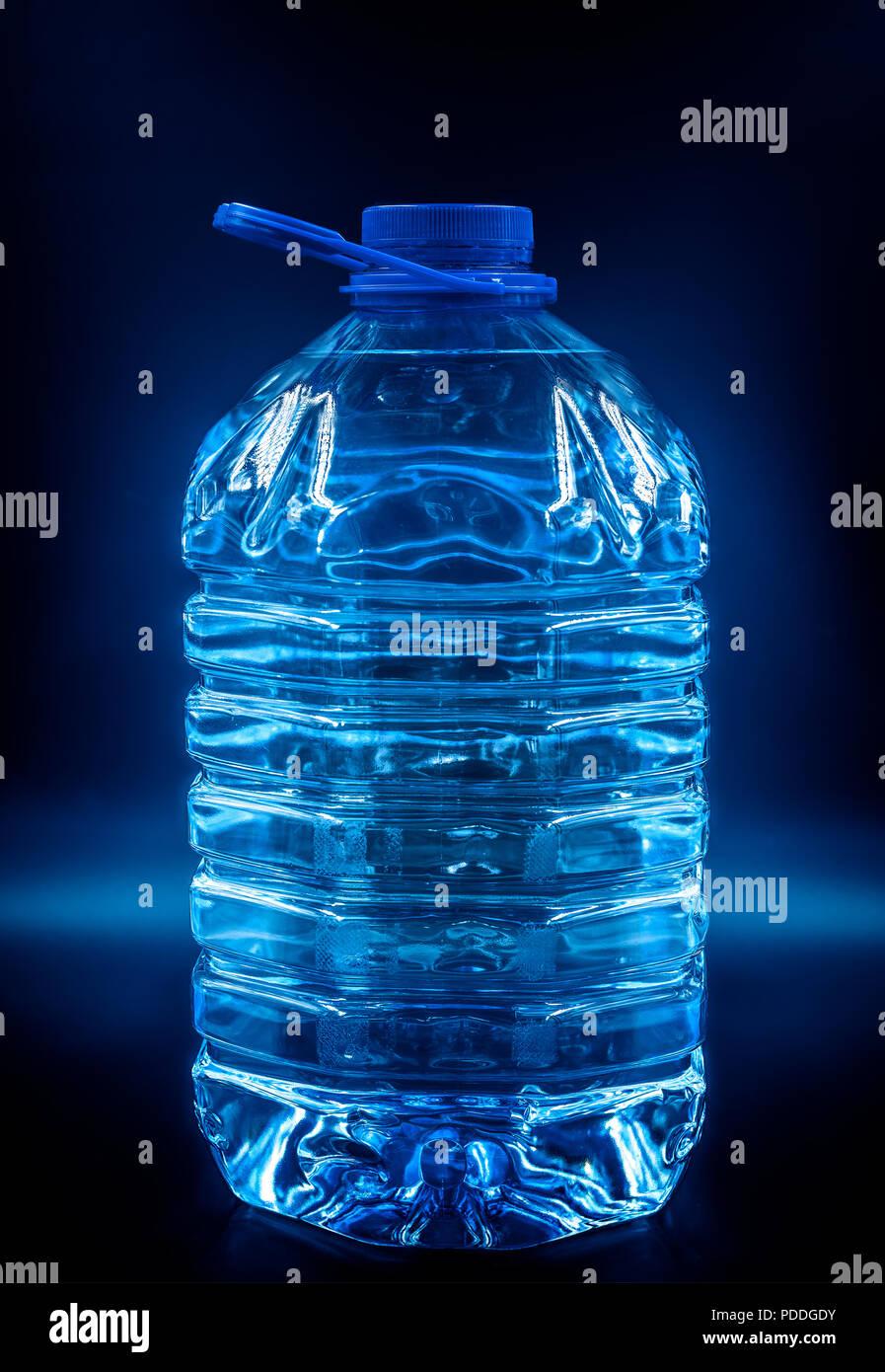 bottled water in dark - Stock Image