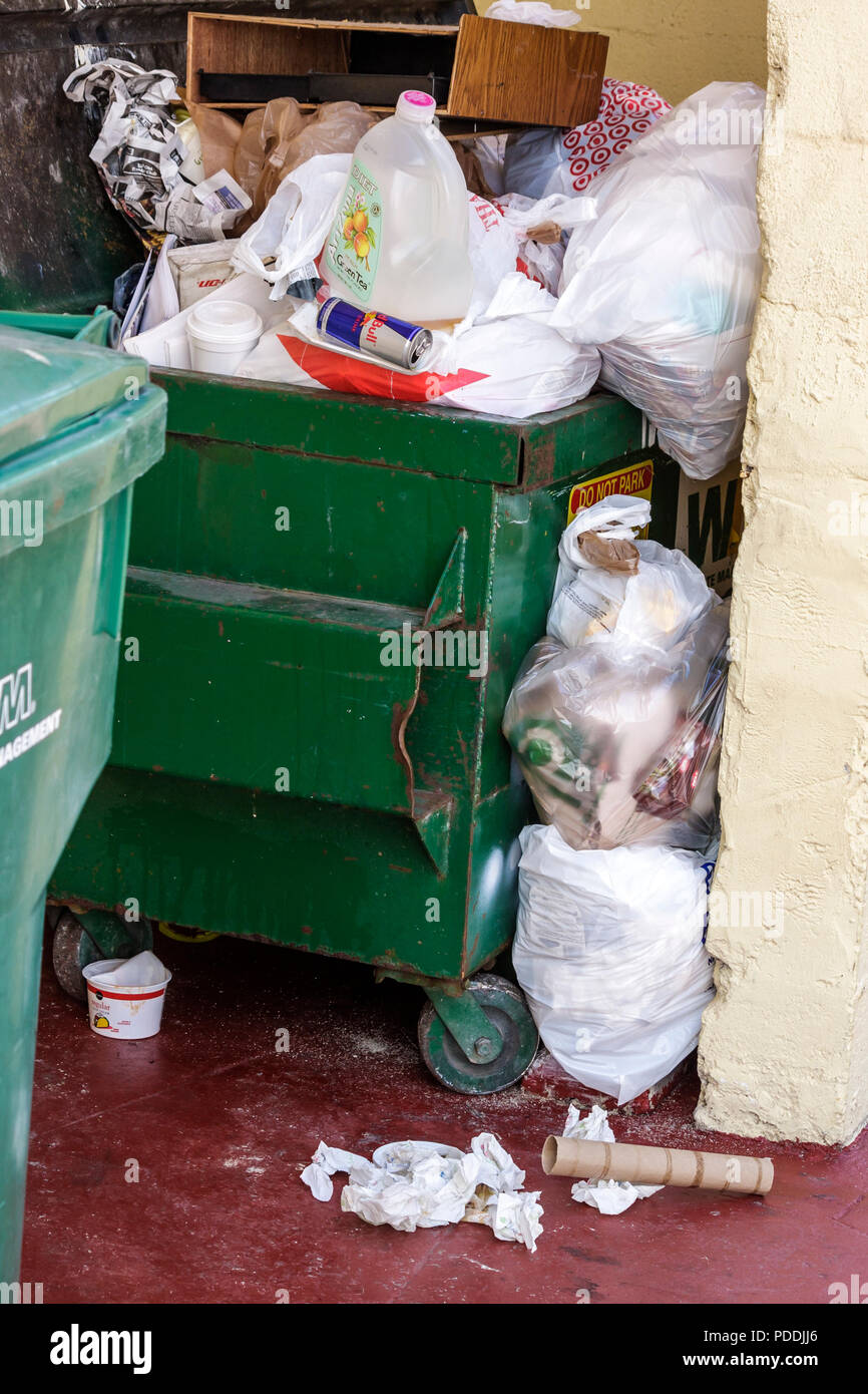 Miami Beach Florida Fifth 5th Street trash bin plastic bags refuse garbage dispose solid waste non-biodegradable - Stock Image