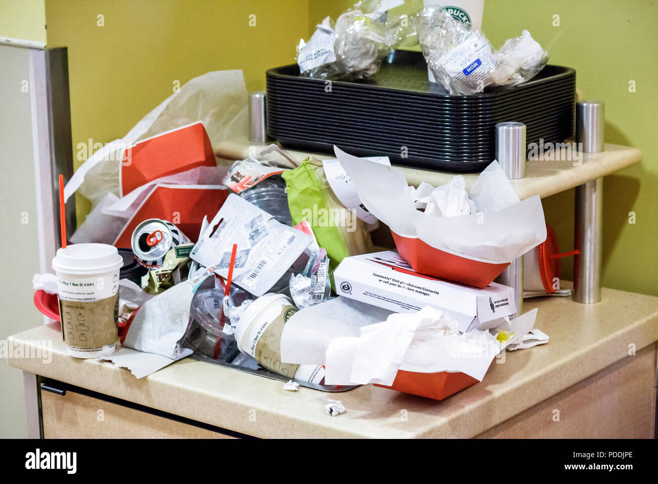 Miami Florida Shops at Midtown Target Discount Store trash cups cans food containers paper waste environment dirty nasty overflo - Stock Image