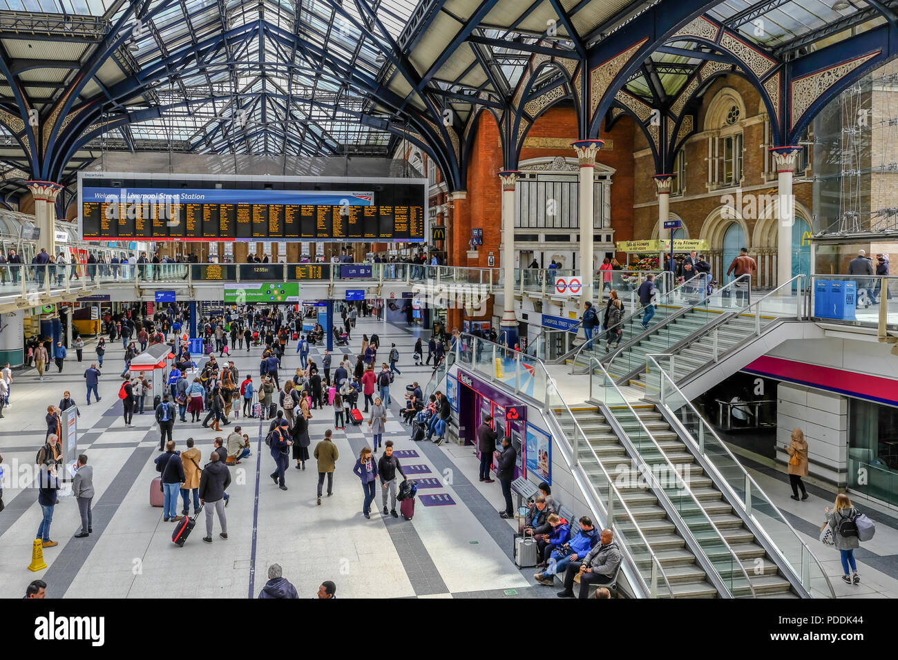 Liverpool Street, London, UK - April 6, 2018: Busy scene inside Liverpool Street mainline station with lots of passengers.  Taken from a vantage point - Stock Image