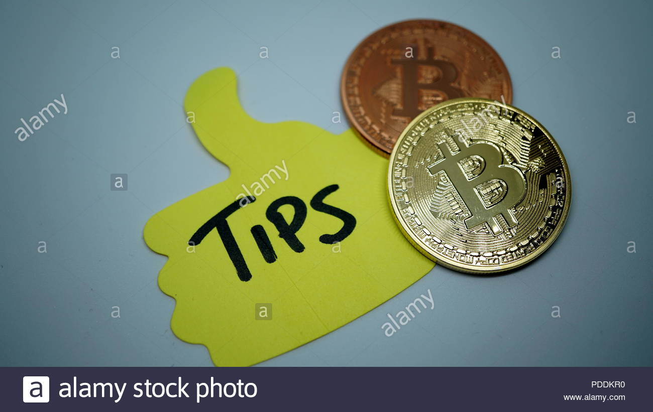 bitcoin gold and copper with written tips on yellow sheet in detail - Stock Image