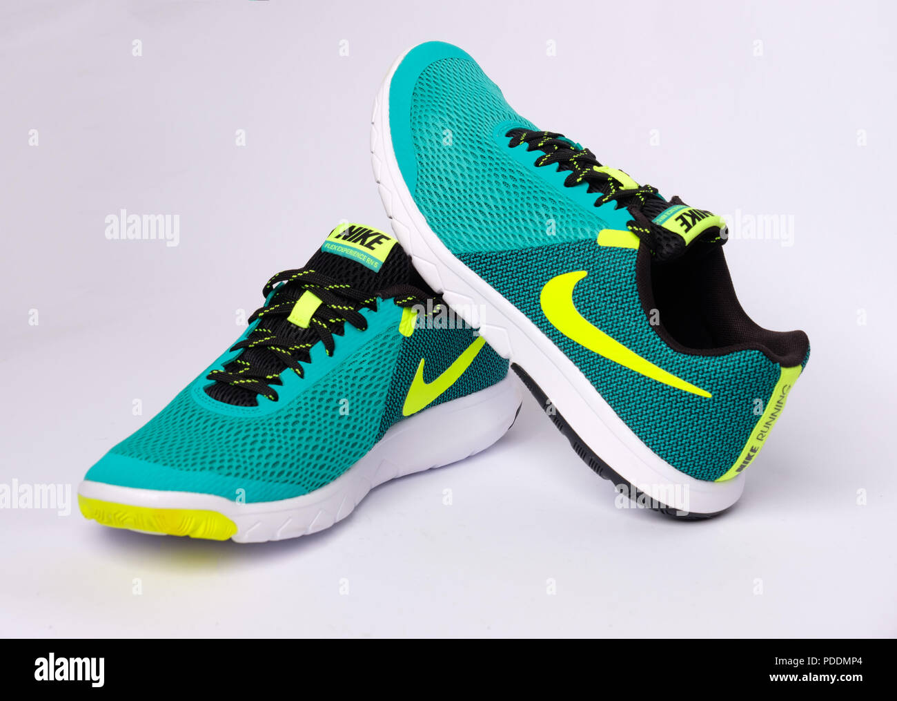 quality design 2532e 5480a Pair of green Nike Flex Experience RN 5 running shoes cut out isolated on white  background