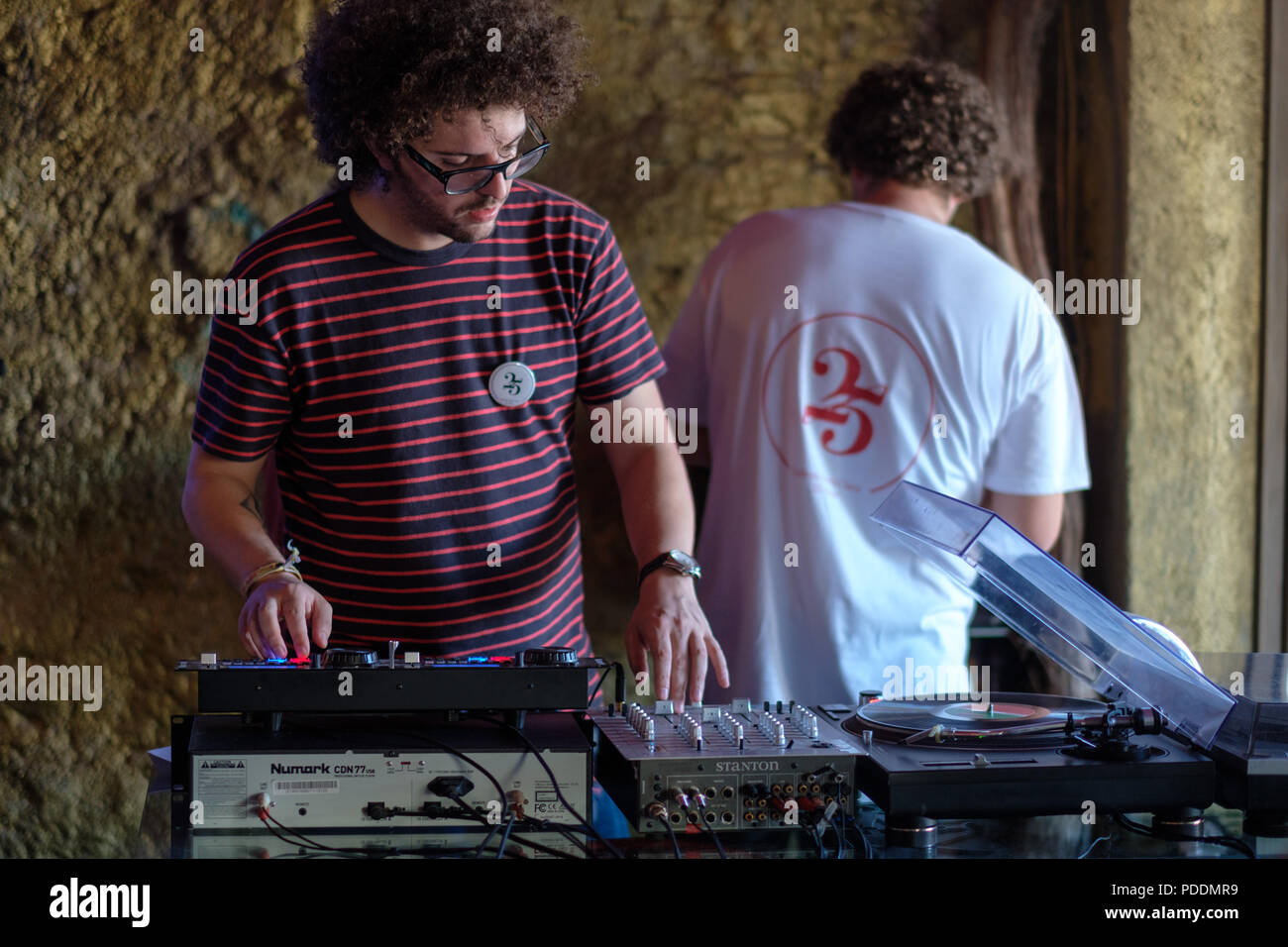 DJ playing music at a party - Stock Image