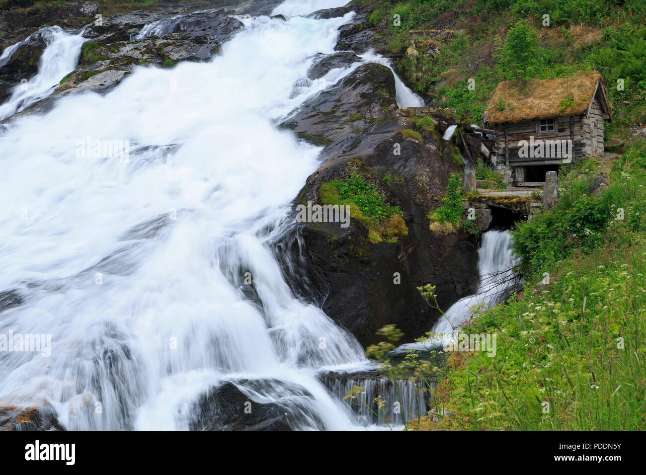 Hellyltfossen Waterfall, Hellesylt Village, More og Romsdal County, Norway - Stock Image