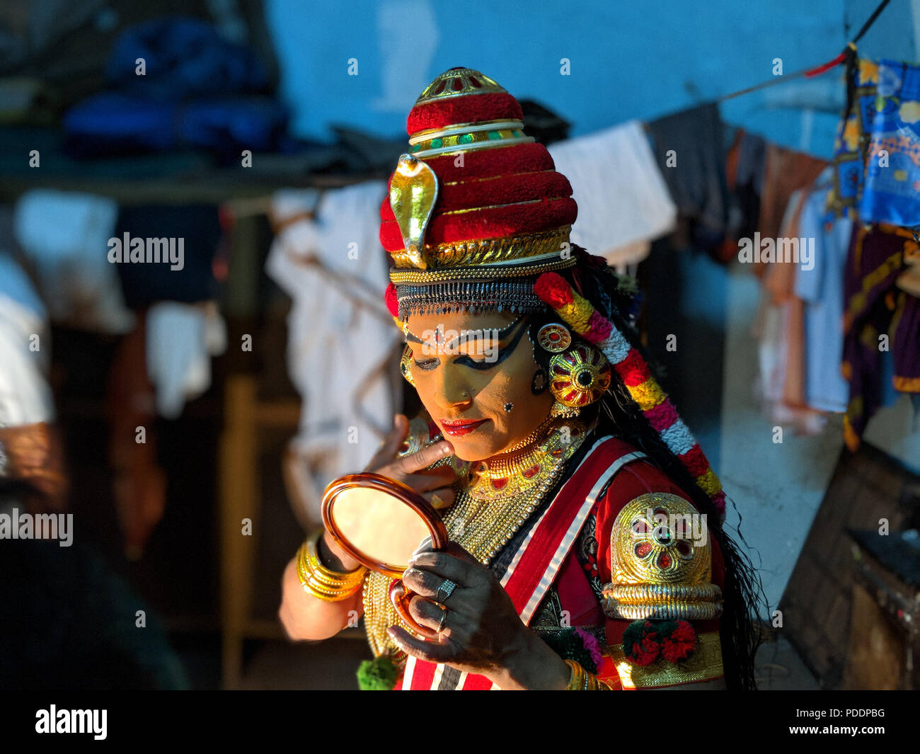 An artist is getting ready to perform Koodiyattam, the traditional performing art form from Kerala - Stock Image
