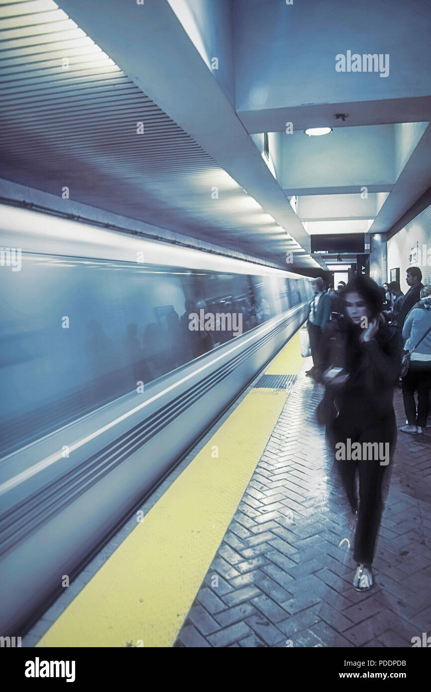 Waiting for the subway in downtwon San Francisco, California, USA. The original photo has been digitally altered to give it a bluish, dreamlike efect. Stock Photo