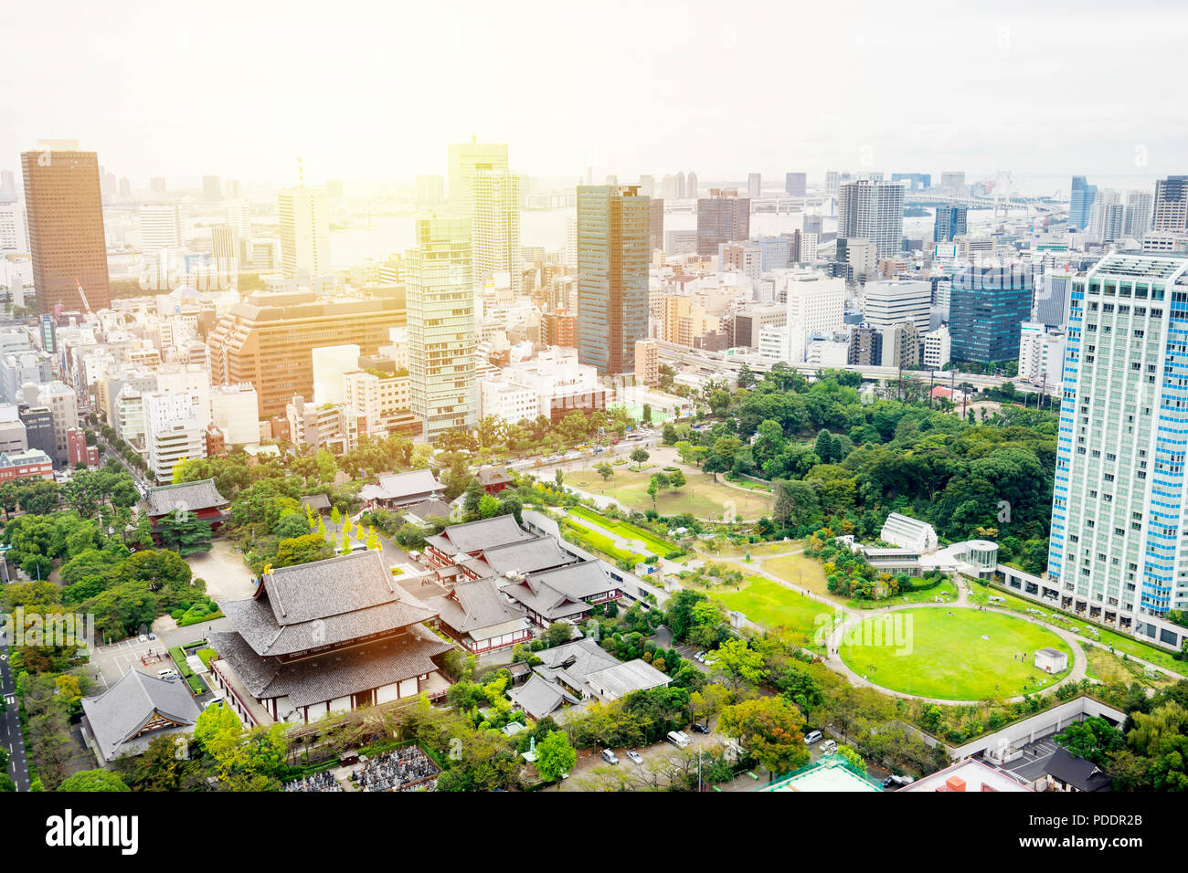 Business and culture concept - panoramic modern city skyline bird eye aerial view with zojo-ji temple shrine from tokyo tower under dramatic sunrise a - Stock Image
