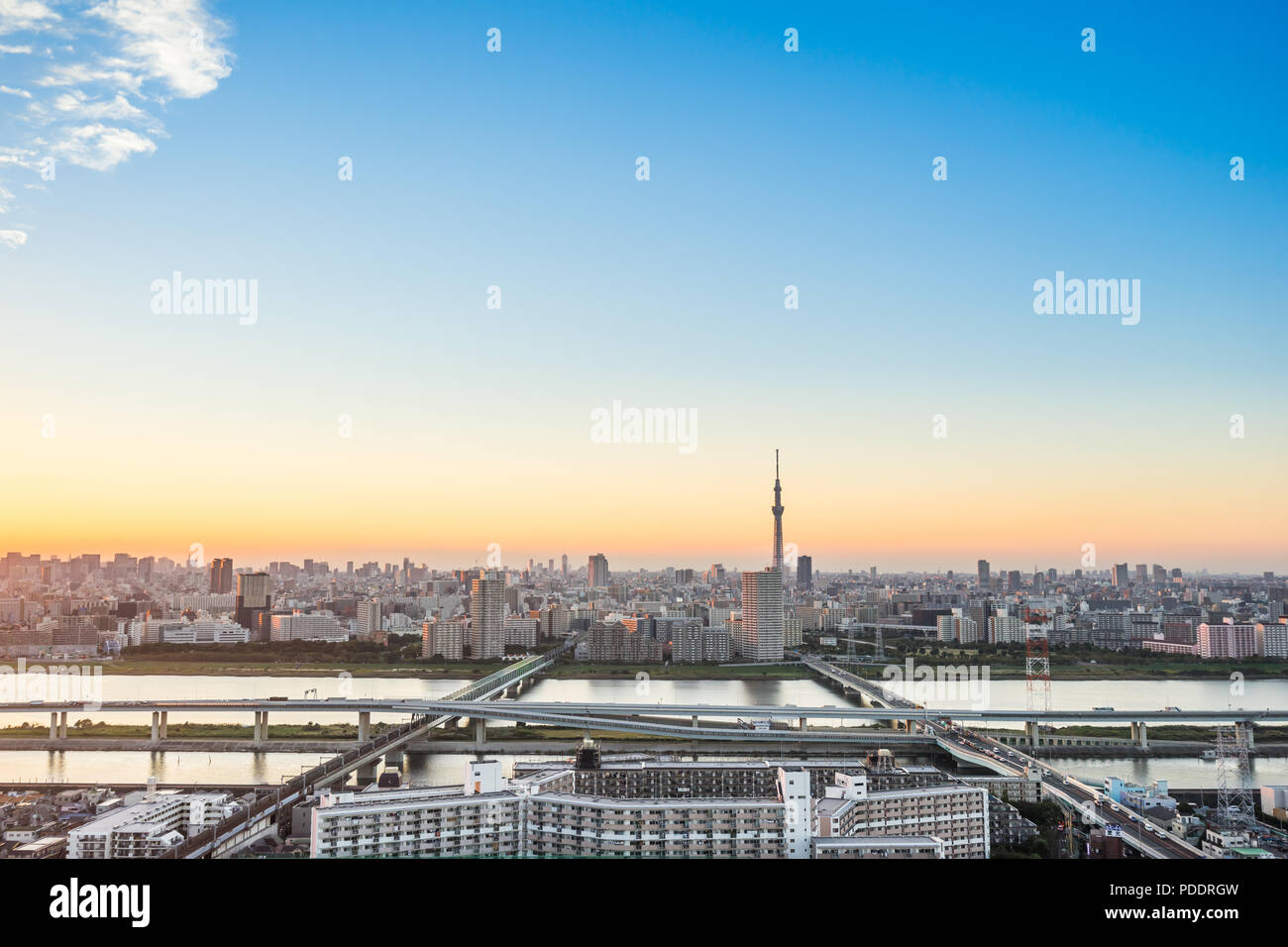Business and culture concept - panoramic modern city skyline bird eye aerial view with tokyo skytree under dramatic sunset glow and beautiful cloudy s - Stock Image