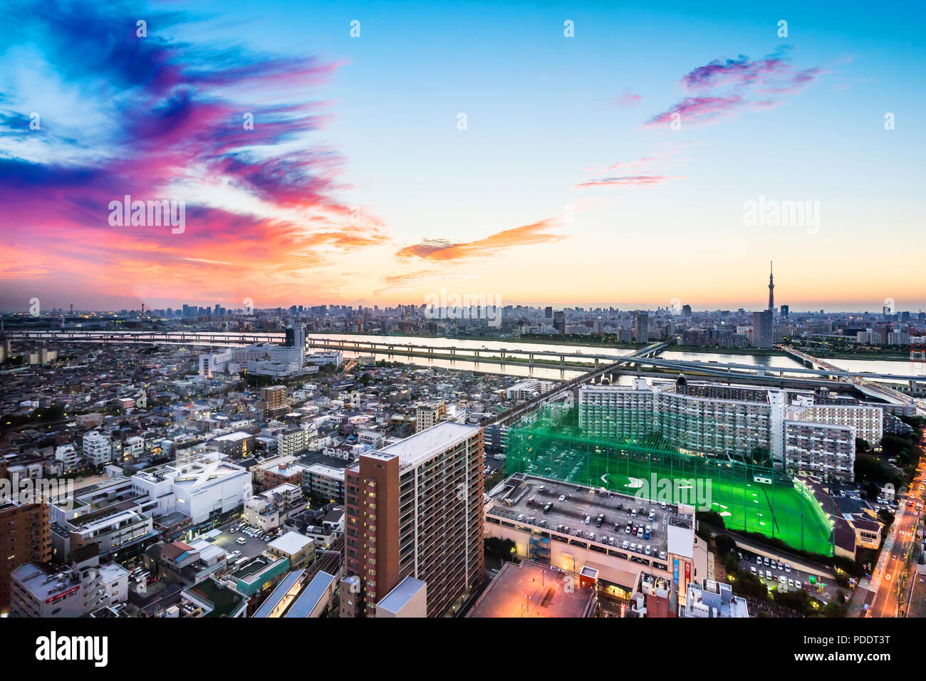 Business and culture concept - panoramic modern city skyline bird eye aerial view with Mountain Fuji and tokyo skytree under dramatic sunset glow and  - Stock Image
