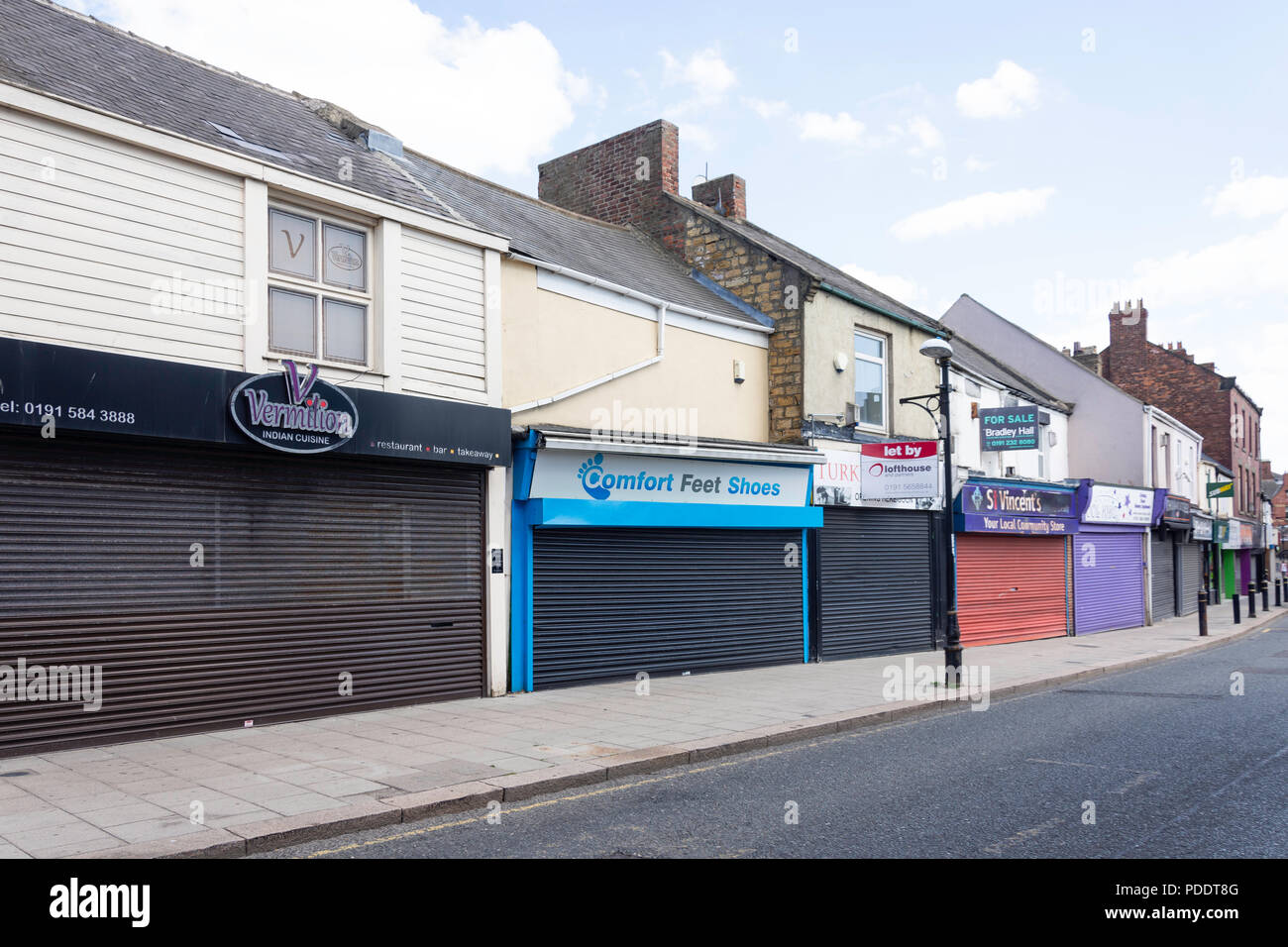 Shuttered shopfronts, Newbottle Street, Houghton-le-Spring, Tyne and Wear, England, United Kingdom - Stock Image