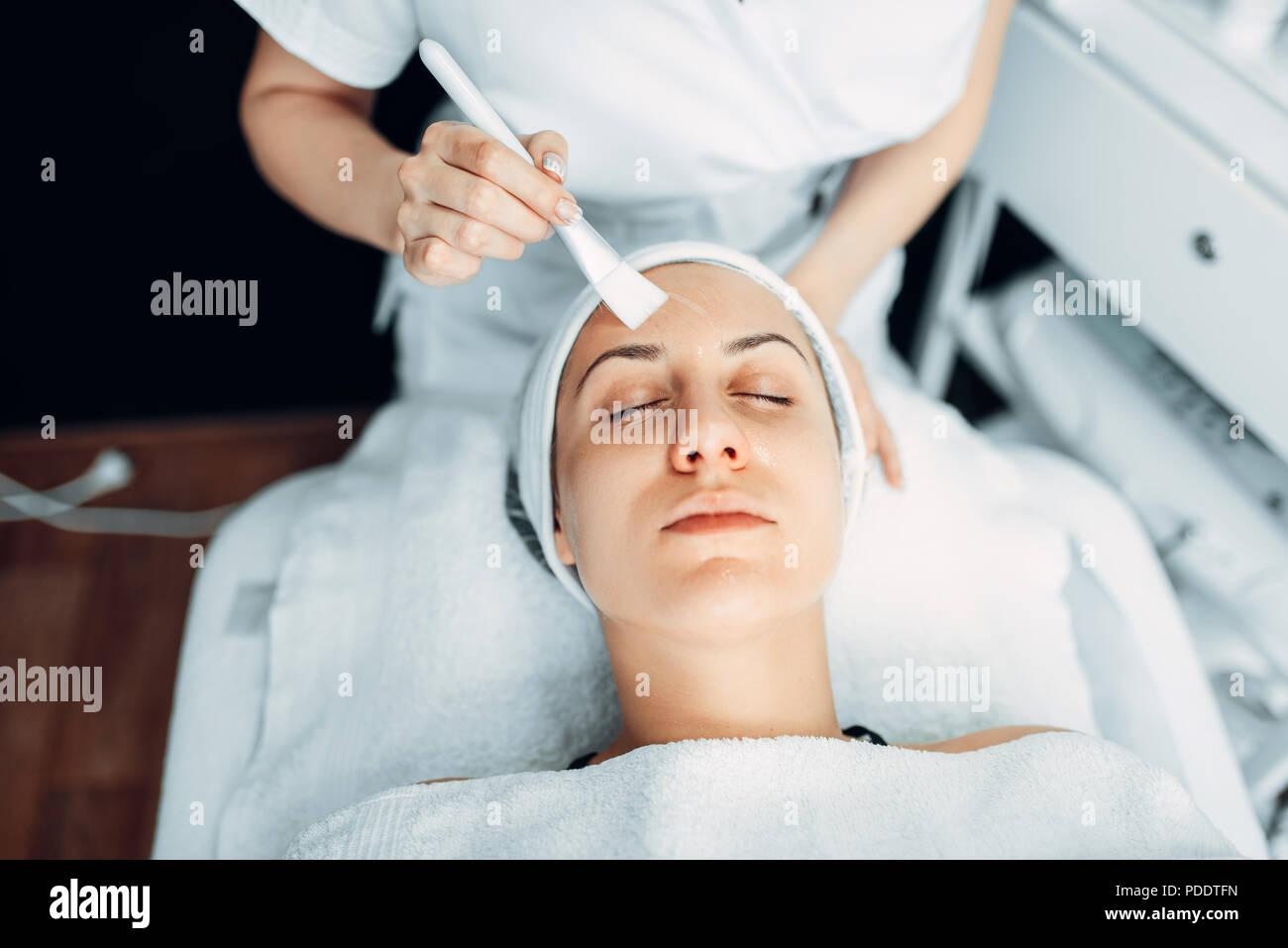 Beautician makes rejuvenation procedure to patient - Stock Image
