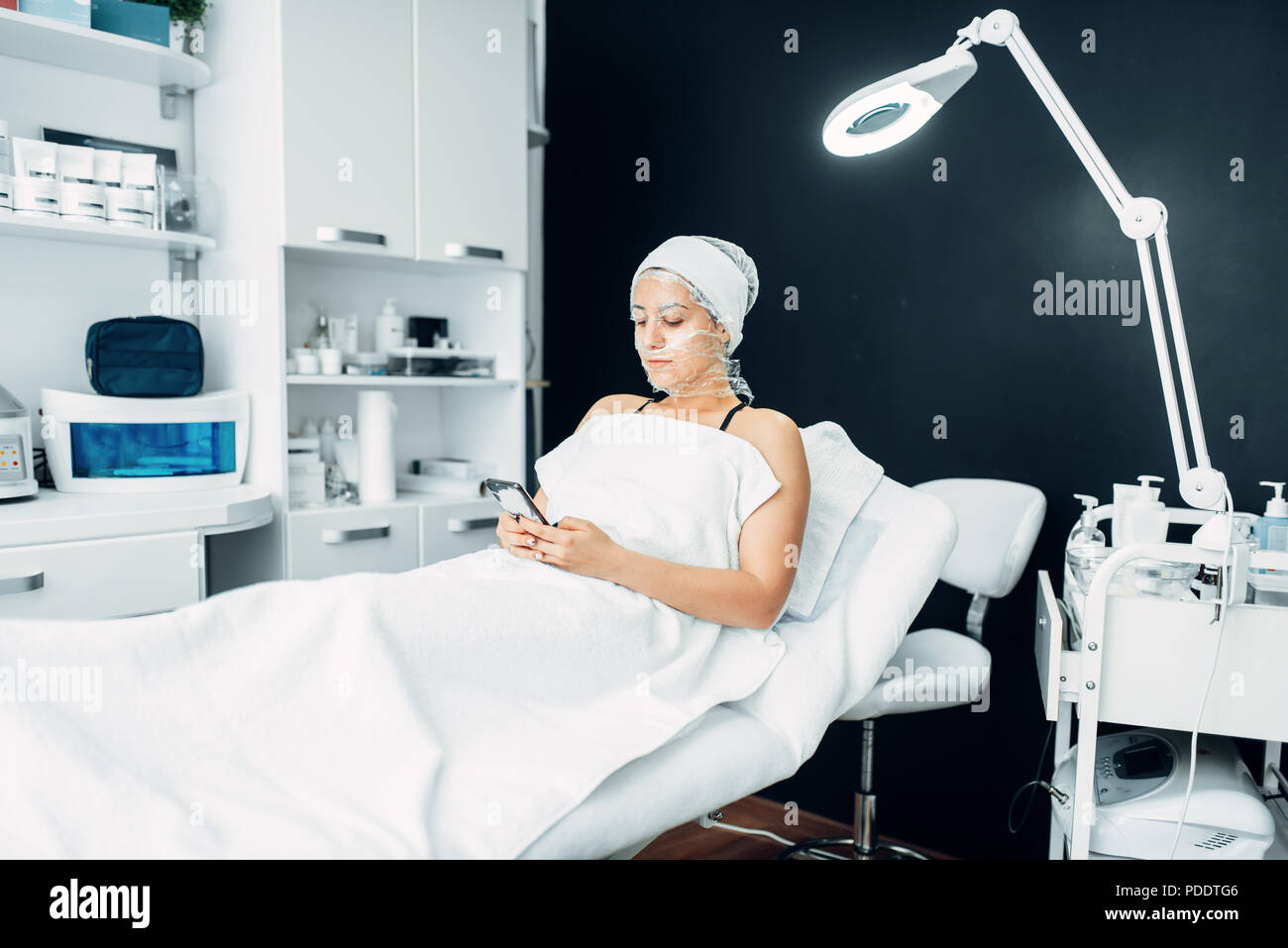 Patient in face mask, getting rid of wrinkles - Stock Image