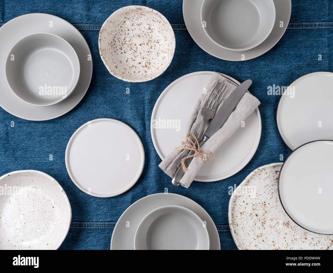 Empty Ceramic Tableware Ceramic Plates On Jeans Tablecloth Or Runner Overview Empty Food Table With Tableware