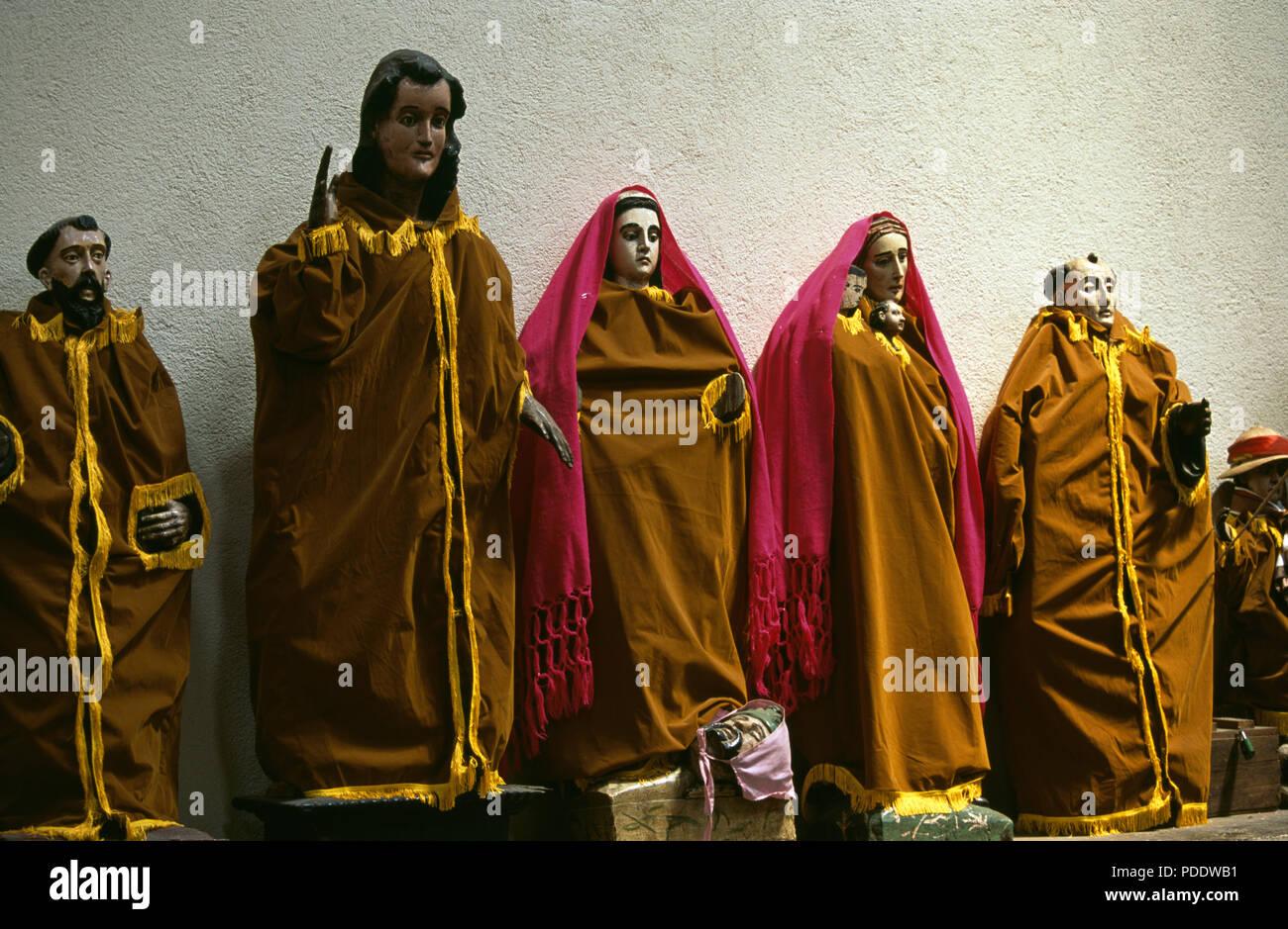 Dressed statues of saints in Catholic church in Santiago Atitlan, Guatemala Stock Photo