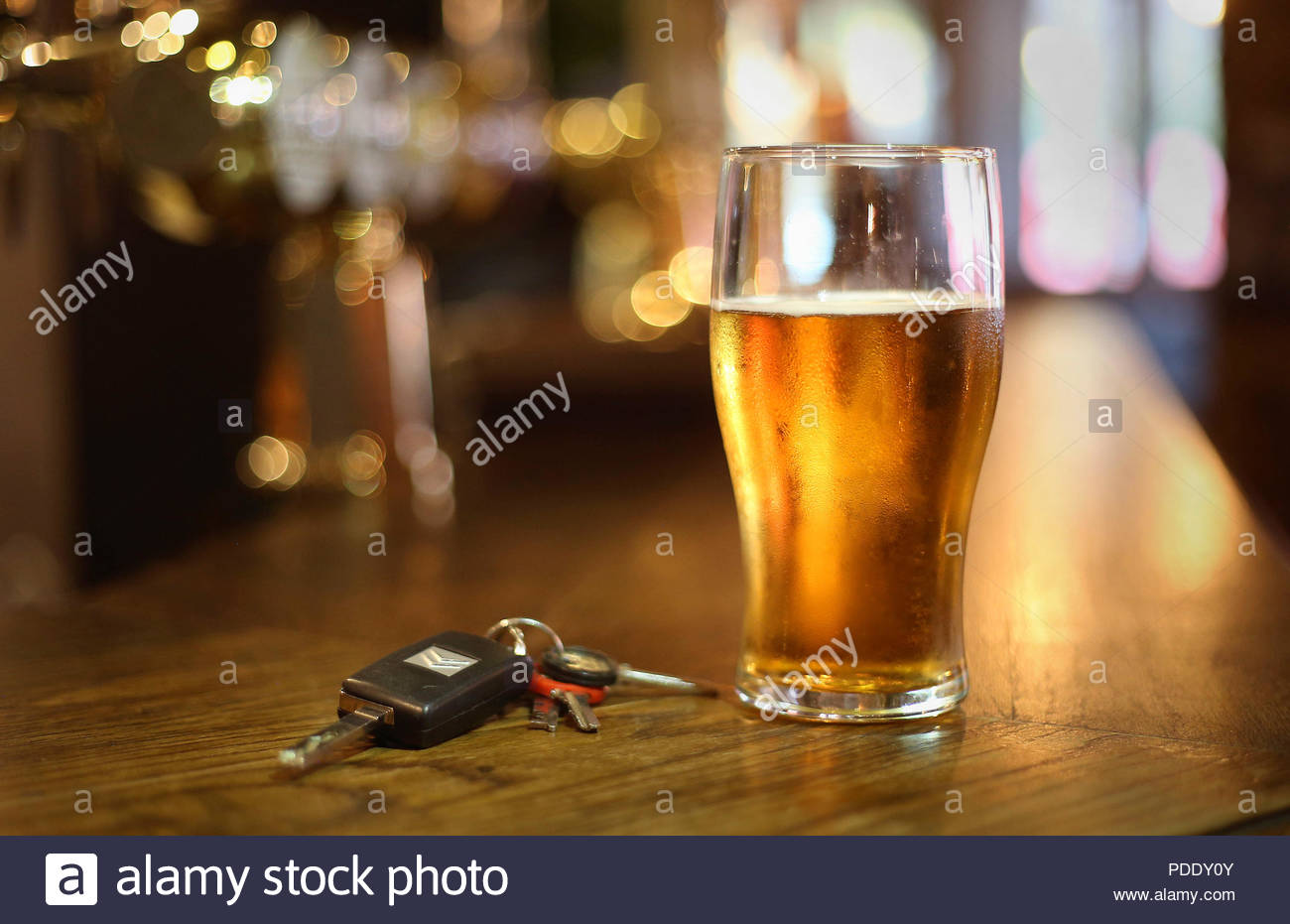 File photo dated 26/11/14 of a pint of beer and a set of car keys on a bar. The number of drink-drive casualties has reached a four-year high, new figures show. - Stock Image