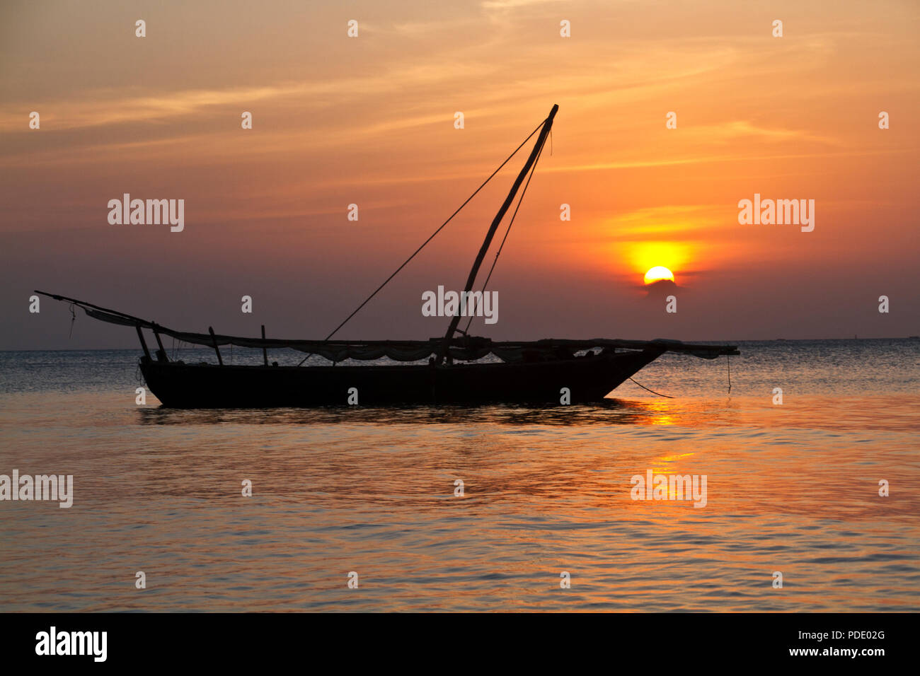 A traditional Johazi is moored off the coast of Zanzibar. A small sailing vessel still in common use along the East African Coast. - Stock Image